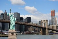 Statue Of Liberty Against New York City Skyline