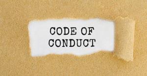 Text Code of Conduct appearing behind ripped brown paper.