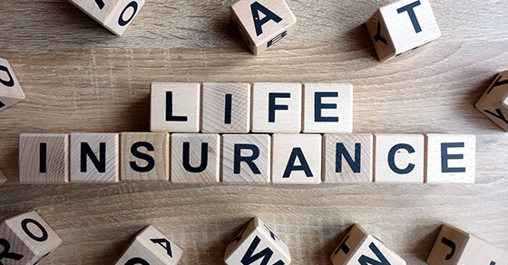 Scrabble letters spelling out life insurance