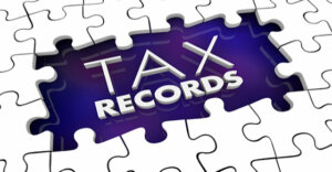 "puzzle outline with the words ""tax records"" in the middle"