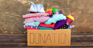 """cloths in a box and the label on the box reads """"donation"""""""