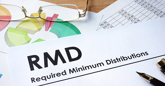 "Desk with a paper that has ""RMD Required Minimum Distribution"" along the top."