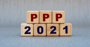 blocks on a table with that spell out PPP 2021