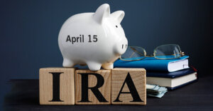 a piggy bank on top of wooden blocks that have IRA painted on them.