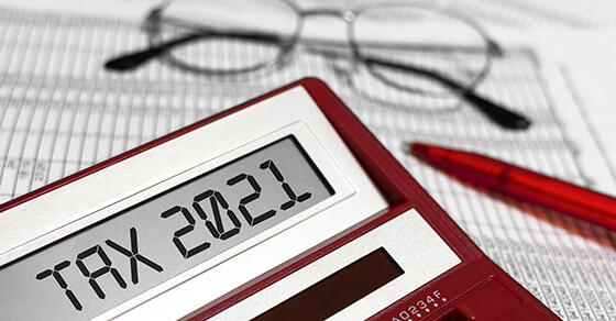 calculator and glasses on top excel documents.