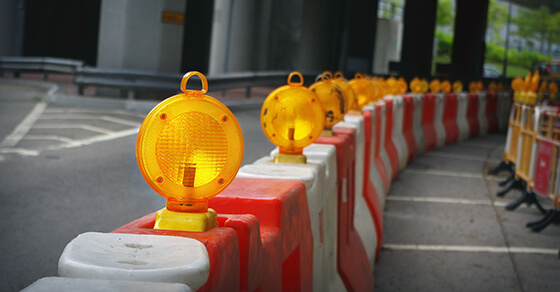 caution lights on a road