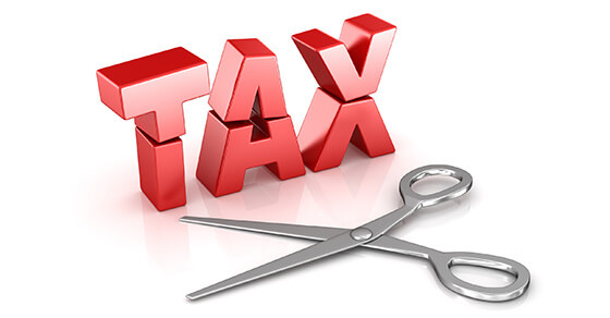 """red block letters spelling out """"TAX"""" and a pair of scissors next to it."""