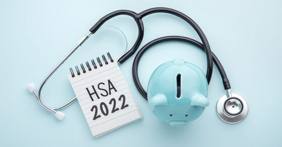 """image of a blue piggy bank, stethoscope, and pad with """"HSA 2022"""" written on it."""