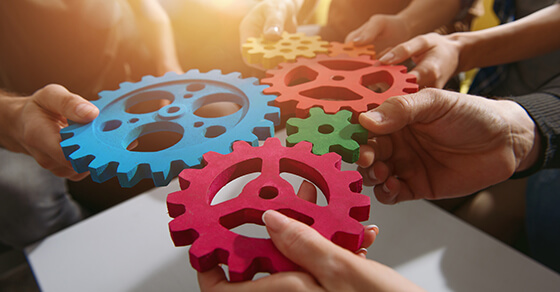 hand held gears of different shapes and colors placed together