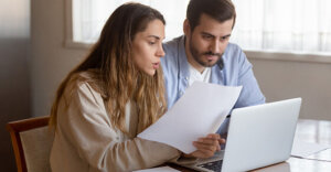a man and a woman looking at a piece of paper