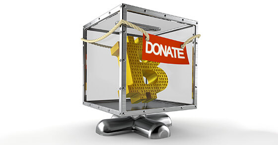 """the symbol of Bitcoin (""""B"""") inside a see-through box with the label """"donate"""" hanging on the front."""