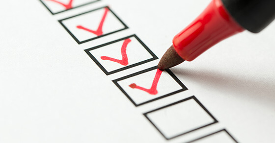 checkboxes on a paper with a red pen and red checkmarks