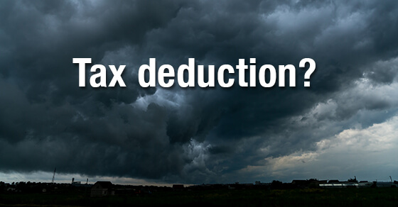 """image of a storm and dark clouds with the words """"tax deduction?"""" in the clouds."""